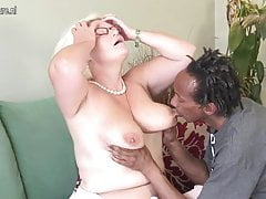 Busty British granny takes young black cock