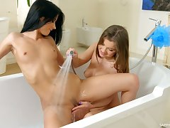 Svelte alluring babe Renata Fox helps her lesbian friend to undress and tease her twat
