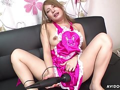 Maid spreads her fingertips and plays with a vibrator